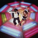 Couple Disco Dancing on Colorful Dance Floor