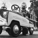Young Boy Playing with Toy Fire Truck