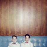 Brothers Smiling Wearing Bowties in Retro Living Room