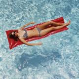 Woman Sunbathing in Swimming Pool Float