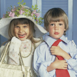 Boy and Girl Dressed Up in Adult Clothing