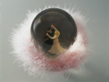 Close-Up of Figurines of Dancers in a Snow Globe