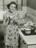Portrait of Young Woman in Kitchen Holding Can of Soup
