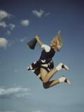 Cheerleader Jumping Holding Megaphone