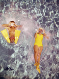 Couple Diving in Swimming Pool