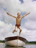 Boy Jumping Off Bow of Boat into Water