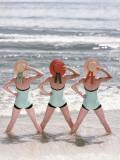 Women Standing on Beach in Ocean