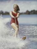 Happy Retro Woman Water Skiing
