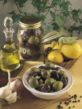 Close-Up of Olives with Garlic and a Bottle of Olive Oil