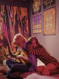 Hippie Couple in Psychedelic Bedroom
