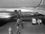 Passengers Disembarking Plane
