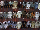 Muslim worshippers pray in Kuwait City's Grand Mosque just before dawn on September 17  2009