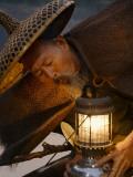 China  Guangxi Province  Yangshuo  Fisherman with Oil Lamp on Bamboo Raft on the Li River at Sunset
