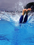Female Swimmer Diving into Pool