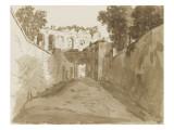 Chemin encaissé entre de hautes murailles et ruines