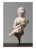 Figurine grotesque : femme aux traits négroïdes allaitant un enfant dont il reste que la partie
