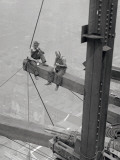 Workers Sitting on Steel Beam