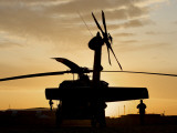 A UH-60L Black Hawk Helicopter Silhouetted by the Setting Sun