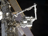 The Canadarm2 Mates the Express Logistics Carrier to the Outboard Payload Attachment System