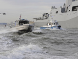 Crews from the Coast Guard and Police Departments Escort Uss New York into New York Harbor