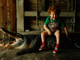 A Five Year Old Boys Sits on a Dead 10-Foot Long Alligator