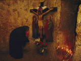 A Greek Pilgrim Prays in the Grotto Where Jesus Was Sentenced to Die