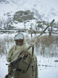 Man in Wool Scarf and Coat Poses with East India Company Rifle