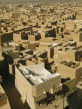 Castellated Walls of Mud Brick Shade Rooftops in Heart of Old Town