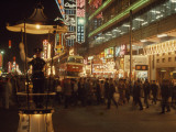 Pedestrians Swarm Through Kowloon's Shopping District