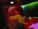 A Couple in a Warm Embrace Dance the Tango