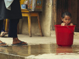 Bhutanese Boy Bathing in a Bucket