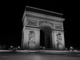 Traffic Passes the Arc De Triomphe at Night