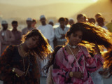 Dancers Swing their Hair at a Festival in Muscat