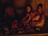 A Topless Tahitian Dancer Is Annointed with Coconut Oil by Firelight
