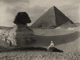 A Man Sits in Front of the Great Sphinx and Near the Cheops Pyramid