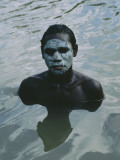 Aboriginal Teen with a Mask of Mud  Swimming in a Billabong