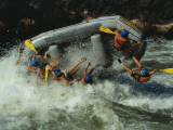 Class V Rapids Flip a Raft Full of Whitewater Enthusiasts