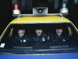 Triplet Policemen in a Police Car