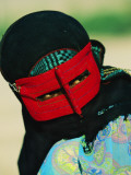 An 18-Year-Old Muslim Woman Wears a Traditional Masks