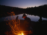 Men and Dogs Sit by a Campfire in New York&#39;s Adirondack Mountains