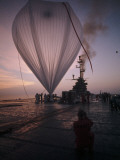 A Naval Hot-Air Balloon Tugs at its Launch Pad on the USS Antietam