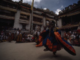 Crowds Gather to Watch Masked Celebrants Whirl in Ritual Dances