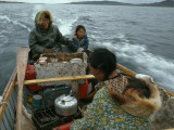 An Inuit Family Travels a Long Distance in an Open Boat