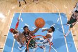 Milwaukee Bucks v Denver Nuggets: Larry Sanders  Carmelo Anthony and Nene
