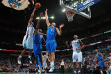Dallas Mavericks v New Orleans Hornets: Willie Green  Brendan Haywood and Dirk Nowitzki