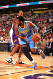 Denver Nuggets v Phoenix Suns: Nene Hilário and Channing Frye