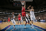 Chicago Bulls v Dallas Mavericks: Taj Gibson  Dirk Nowitzki and Caron Butler