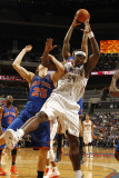 New York Knicks v Charlotte Bobcats: Kwame Brown and Timofey Mozgov