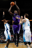 Sacramento Kings v New Orleans Hornets: Samuel Dalembert  David West and Jason Smith