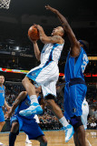 Dallas Mavericks v New Orleans Hornets: Jerryd Bayless and Brendan Haywood